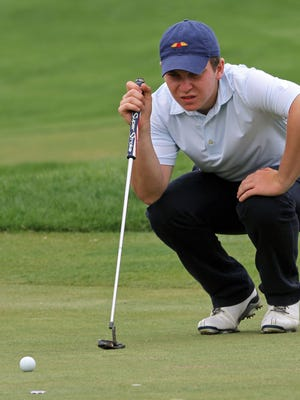 Pingry's Jake Mayer lines up a putt on the18th green at the Skyland Conference Golf Championships at Royce Brook Golf Club in Hillsborough.