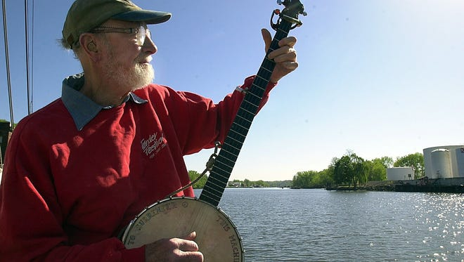 Pete Seeger, shown in May 2001, plays the banjo aboard the Hudson River Sloop Clearwater while the ship is docked in Rondout Creek, a tributary of the Hudson River in Kingston, N.Y. Seeger was one of the founders of the sloop in 1966.
