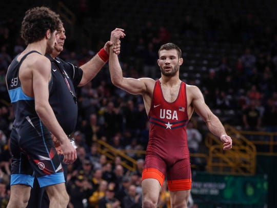 Team USA's Thomas Gilman, right, beat Georgia's Teimuraz Vanishvili, 6-4, at 57 kg during the freestyle wrestling World Cup in Iowa City on Sunday, April 8, 2018.