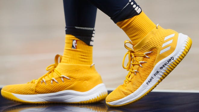 "Utah Jazz guard Donovan Mitchell, a former University of Louisville player, wears a shoe with ""Pray for Parkland"" written on it, during the second half of the team's NBA basketball game against the Phoenix Suns on Wednesday, Feb. 14, 2018, in Salt Lake City."