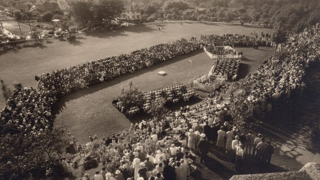 Lincoln High School holds its first outdoor graduation ceremony on June 13, 1934.