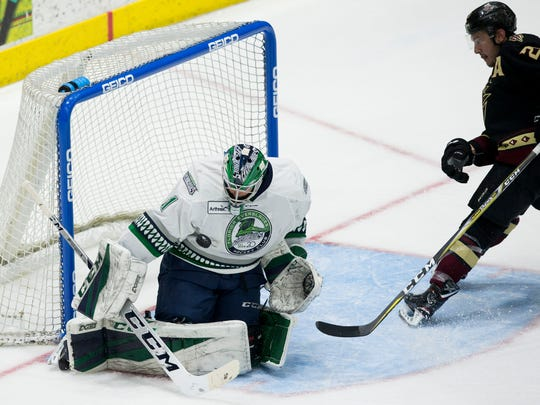 Florida Everblades goalie Martin Oullette (51) blocks a potential goal against the Atlanta Gladiators during the second period of Game 1 of the first round of the ECHL playoffs at Germain Arena on Monday in Estero. After two period the score was 1-1.
