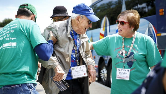 Joan Bortolon, president of Land of Lincoln Honor Flight, chats with Fred Roderick, a World War II veteran, on a 2018 flight.