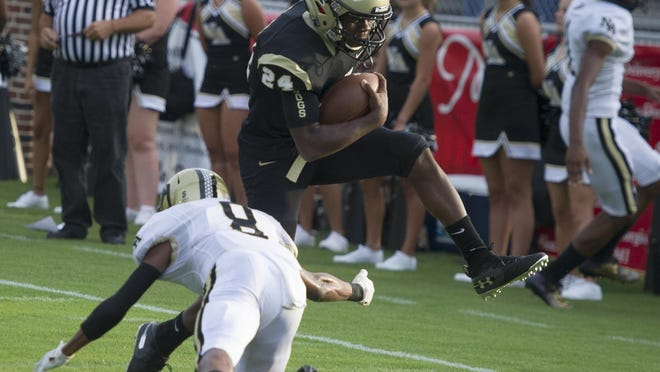 Cerauhjalaun Williams of Thomson scores a touchdown as he makes way past Jacarri Gamble of North Augusta at the high school football game between North Augusta and Thomson in Thomson, GA, Monday, August 26, 2019.