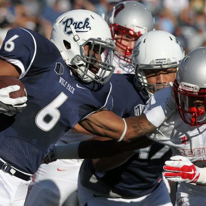 Oct 3, 2015; Reno, NV, USA; Nevada Wolf Pack running