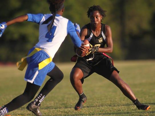 Florida High quarterback Janae Scott plants her foot