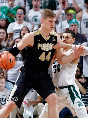 Purdue's Isaac Haas, left, works for position against Michigan State's Gavin Schilling during the second half of an NCAA college basketball game, Saturday, Feb. 10, 2018, in East Lansing, Mich. Michigan State won 68-65.