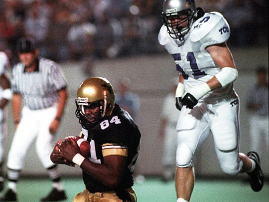 Vanderbilt tight end O.J. Fleming (84) pulls in a pass for a touchdown against TCU, as linebacker Scott Taft (51) chases on Sept. 20, 1997.