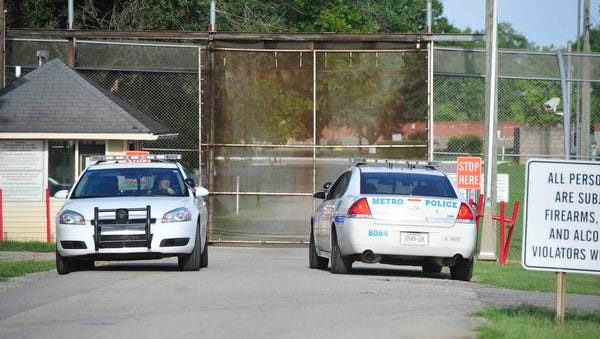 Police and officials work the scene on Tuesday, Sept. 2, 2014, after 32 teenagers escaped from Woodland Hills Youth Development Center Monday night in Nashville. Seven were still at large on Tuesday.