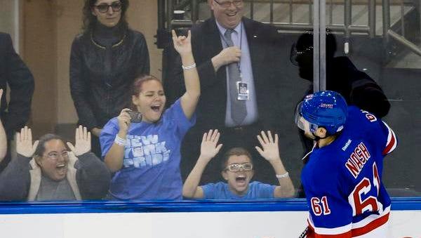 Rangers fans cheer after Rick Nash scored in the shootout against the Carolina Hurricanes Thursday night. The Rangers won the game 2-1.