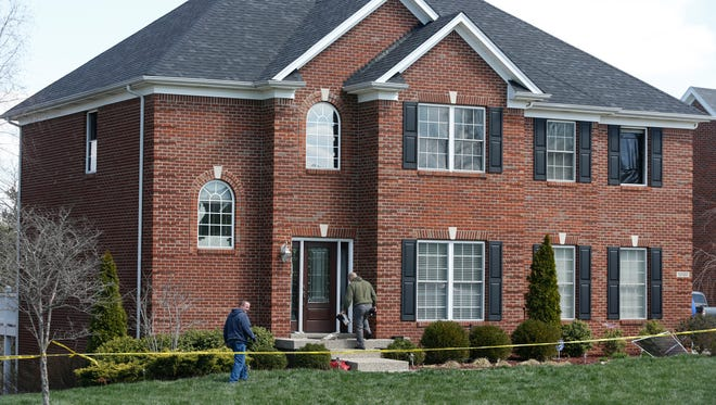 Investigators searched a home in Saratoga Woods where four people died in an apparent murder-suicide.