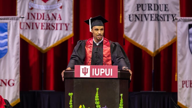 Graduate George Hill gives the student address during the IUPUI Commencement at Lucas Oil Stadium on Saturday May 12, 2018.