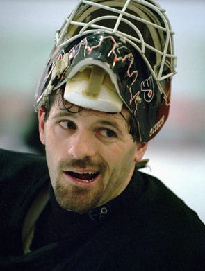 Philadelphia Flyers goalie Ron Hextall takes a break during a team practice in this 1995 photo.