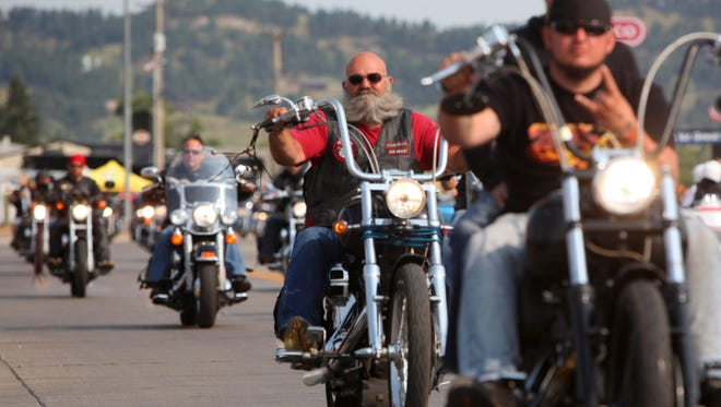 Riders flood the streets of Sturgis, S.D., for the opening day of the 74th Annual Motorcycle Rally in 2014.
