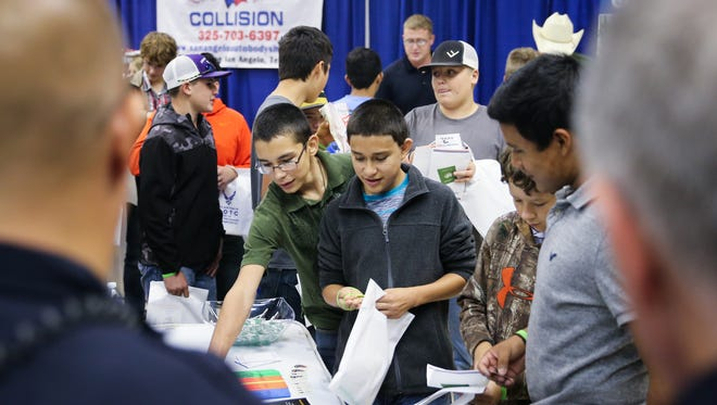 Panther Creek eighth-graders check out booths with friends during the San Angelo Business Expo Wednesday, Sept. 27, 2017, at McNease Convention Center.