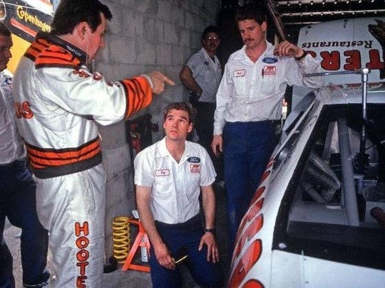 Alan Kulwicki tells Ray Evernham (kneeling) and crew chief Paul Andrews what changes he wants on his car before the 1992 Daytona 500. Evernham, who went on to win three Cup championships and be elected to the NASCAR Hall of Fame, worked for Kulwicki for only about six weeks.
