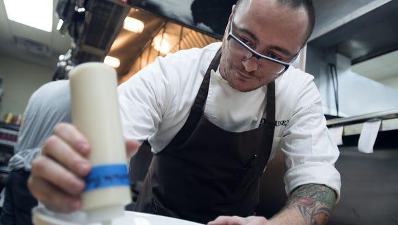 Chef Hari Cameron dresses the plate for a wild mushroom