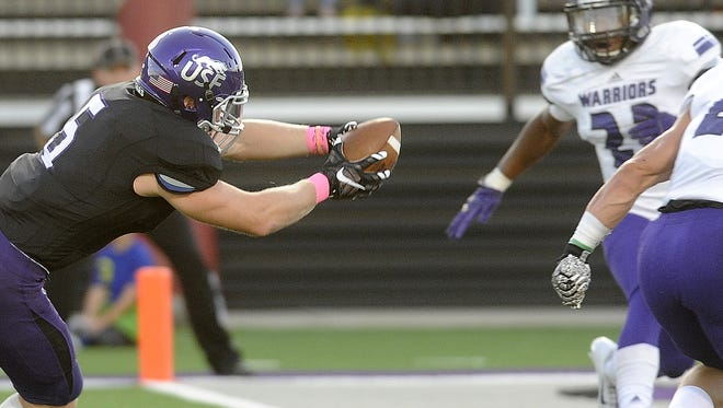 USF's #5 Brady Rose scores against Winona State during football action at Bob Young Field in Sioux Falls, SD; Saturday, Oct. 10, 2015.