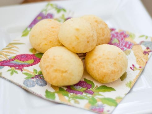 Brazil: Steaming warm, fresh-from-the-oven pao de queijos, round-shaped