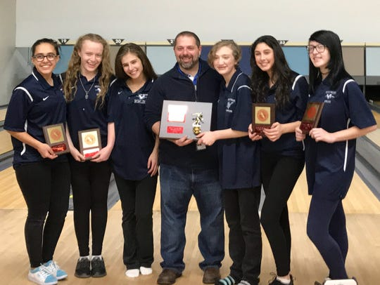 The Wayne Valley girls bowling team celebrates winning