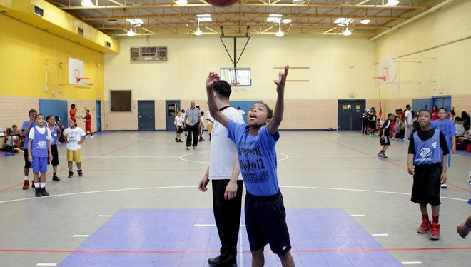 """Players warm up during a basketball tournament at the Boys and Girls Club in 2016. The """"Yes! I Can!"""" program will have similar fitness games, starting Monday, Feb. 10, 2020."""