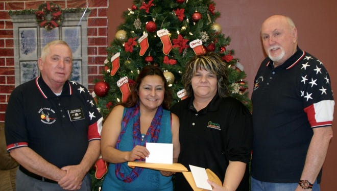 At the presentation of the gift cards were, from left, Mesquite Elk member Harold Straley; Roberta Franco, director of The Salvation Army; Krissy Thornton, of the Mesquite Senior Center and Elks member Bill Oskin.