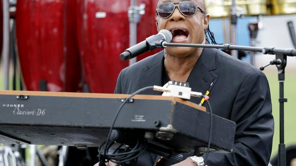 Musician Stevie Wonder performs at a campaign rally