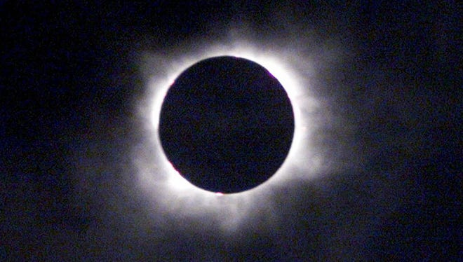 A solar eclipse above Gmunden, Austria, Aug. 11, 1999.