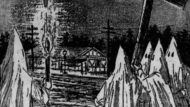 An Asbury Park Press illustration from April 1971 shows the Ku Klux Klan burning a cross in front of the Lakewood train station on Feb. 16, 1923. The event depicted actually happened and was intended to signal to the public the official arrival of the KKK in Ocean County.