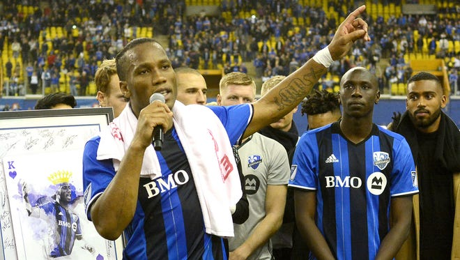 Didier Drogba speaks to Montreal Impact fans during a postgame celebration after his final home game at Olympic Stadium.