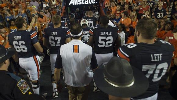 Auburn head coach Gus Malzahn walks out with Auburn