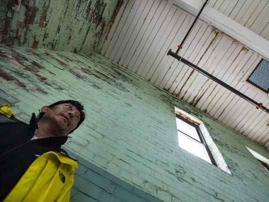 Sangay Dhondup, facilities coordinator at Memorial Auditorium in Burlington, shows where water has leaked through the aging structure's roof and penetrated the walls, possible affecting the structural steel, on Thursday, October 1, 2015.