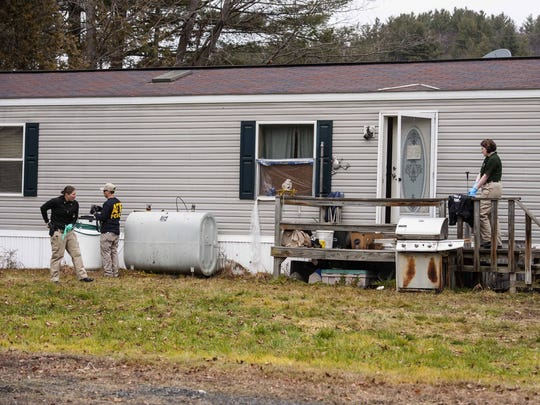 Investigators search a home in Berlin on Wednesday,