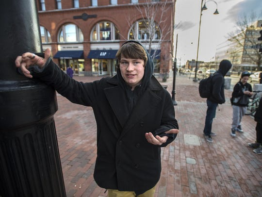 Lee Benoit, 18, of Burlington, discusses his smoking