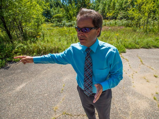 Bryan Osborne, Colchester's Director of Public Works, stands Thursday at the location where the proposed and long-delayed Circumferential Highway was to have intersected with Route 127 in Colchester. Photographed on Thursday, September 1, 2016.