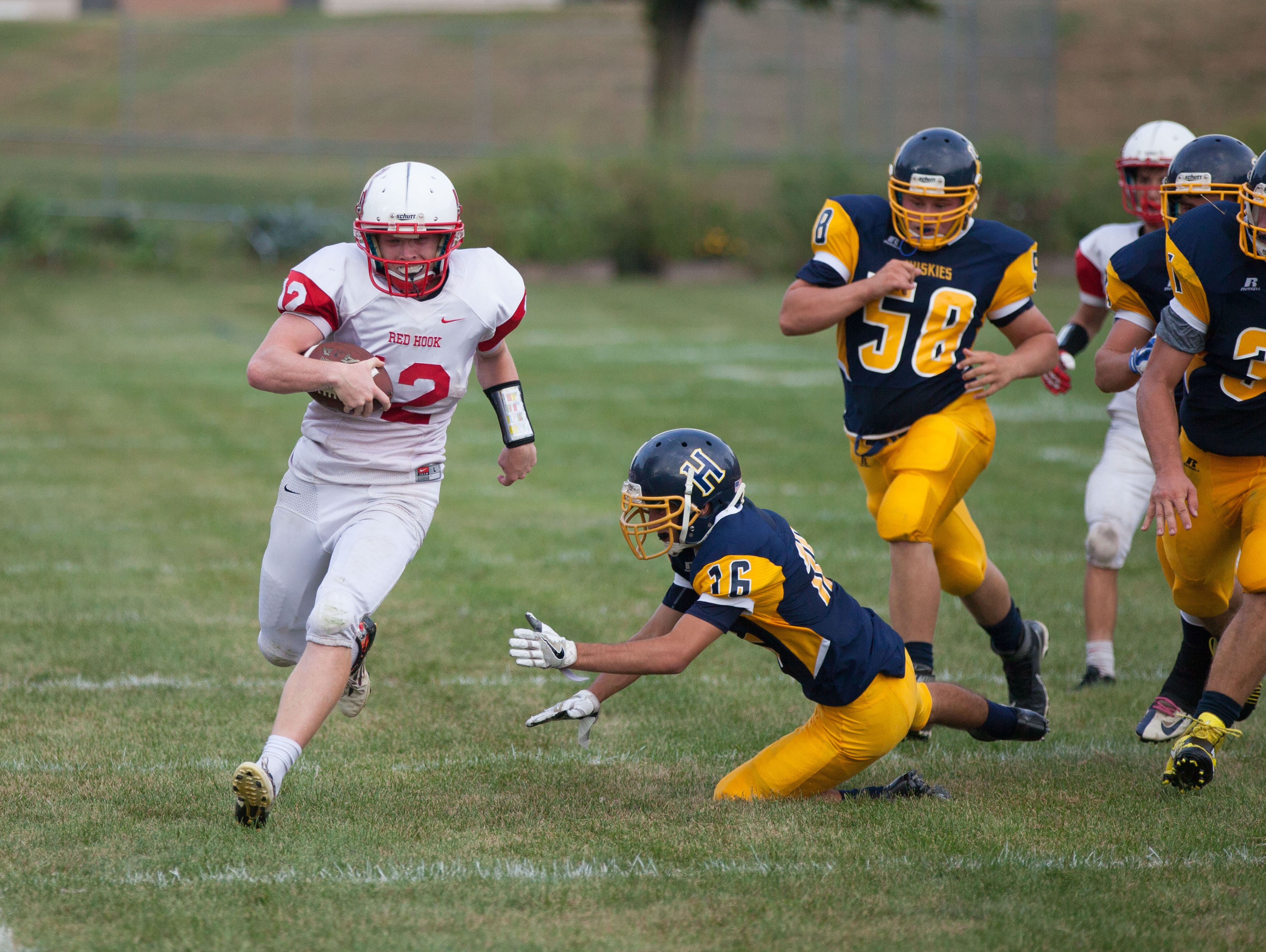 Red Hook's Nick Morrissey eludes the Highland defense to convert his run into a touchdown on Saturday at Highland Middle School.