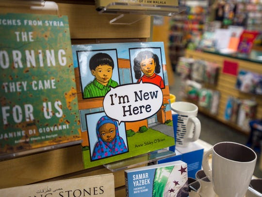 A display of books featuring the plight of refugees