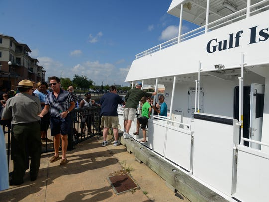 Media and special guests tour the Turtle Runner ferry boat on April 22. It is one of two ferry boats that will provide passenger ferry service between downtown Pensacola, Pensacola Beach and Fort Pickens.