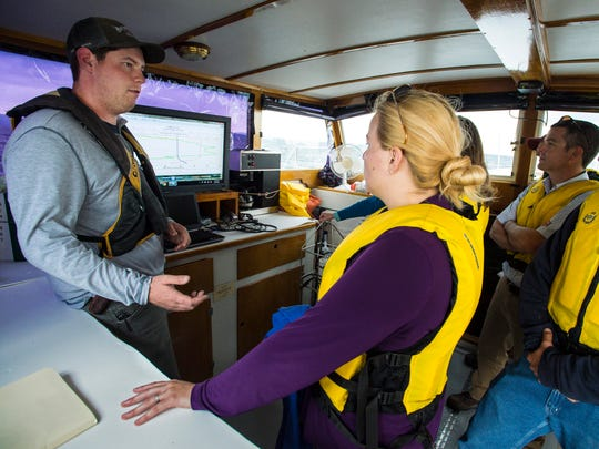 "Brad Roy from the University of Vermont's Rubenstein Science Ecosystem Laboratory explains how he gathers data using an underwater sensor aboard the university's research vessel ""Melosira"" on Lake Champlain on Thursday, September 7, 2017. Roy was speaking to a group of storm and waste water professionals touring two sites affected by those outflows."