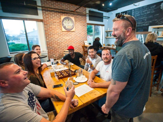 Co-owner Mike Drake greets customers at the 1st Republic Brewing Company taproom in Essex on Friday, November 3, 2017.