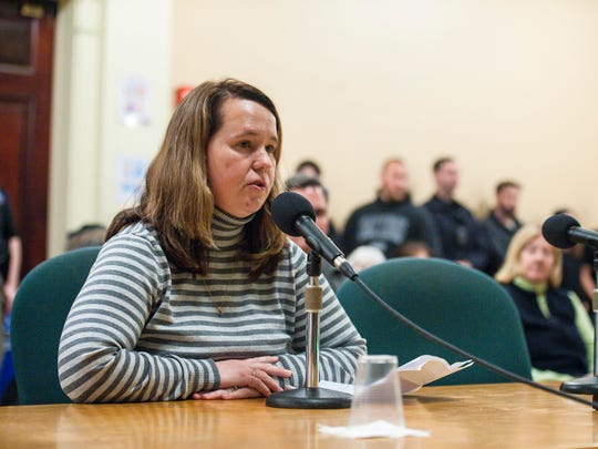 Burlington dispatcher Christy Lorrain speaks against a proposed regional dispatch center during a meeting of the Burlington City Council on Monday, December 18, 2017.