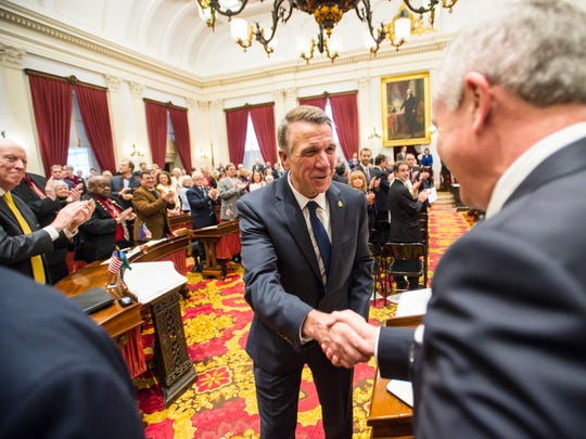 Gov. Phil Scott leaves the House of Representatives chamber after delivering his State of the State address at the Statehouse in Montpelier on Thursday, January 4, 2018.