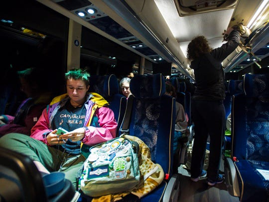 Burlington student Cory Kuttner sits onboard a bus at South Burlington High School on Friday, March 23, 2018 before heading to Washington D.C. to participate in Saturday's March For Our Lives.