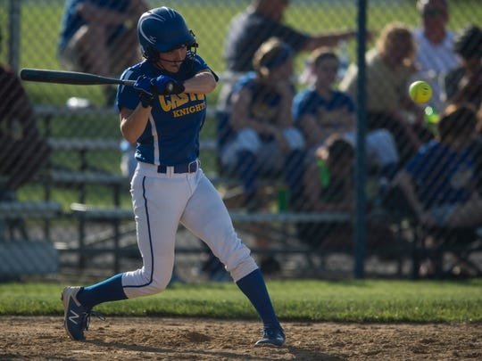 Castle's Hannah Hood (24) swings at the ball against North at Castle High School on Friday, May 11, 2018.