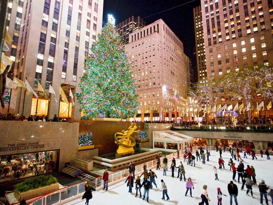 Visitors skate beneath the Rockefeller Center Christmas
