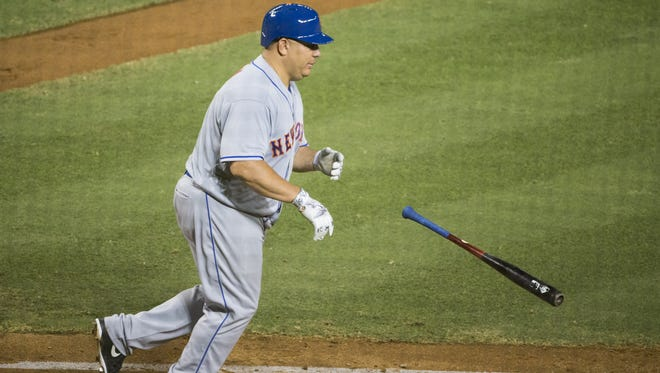 New York Mets pitcher Bartolo Colon tosses his bat after drawing a walk against the Arizona Diamondbacks at Chase Field in Phoenix August 15, 2016.