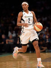 New York Liberty guard Candice Wiggins drives the ball downcourt  during an WNBA basketball game on Thursday, July 16, 2015, in New York. After retiring in 2016, Wiggins claimed she was bullied by gay players because she was straight.
