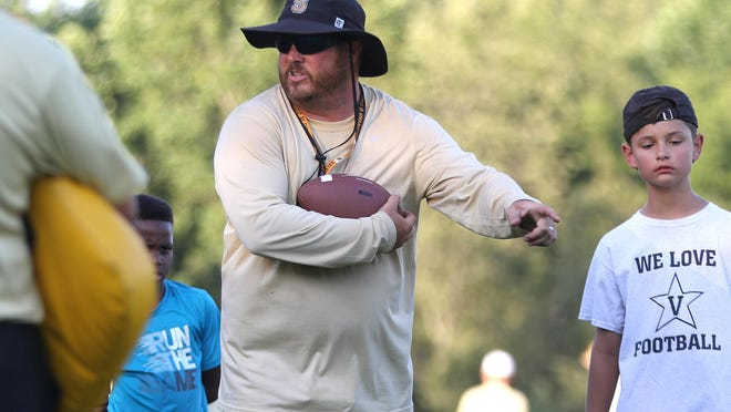 Springfield football coach Dustin Wilson has led the Yellow Jackets to their first state semifinal since 1994.