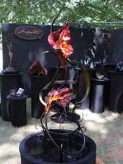 """""""Dancing Lilies"""" by Lisa Arquette is a mesmerizing cast-bronze fountain on exhibit at the 66th annual Salem Art Fair & Festival."""