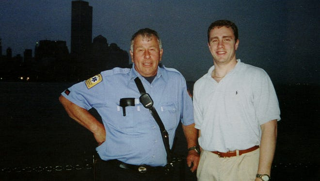 """NYC firefighter Lt. Harry Wanamaker of Upper Nyack, left, with Welles Remy Crowther on a fireboat in New York Harbor, on June 20, 2001. Crowther died saving others in the South Tower of the World Trade Center on Sept. 11, 2001. Welles' father, Jefferson Crowther, who took the photo, said Welles wanted him to include the twin towers in the shot. Wanamaker, who volunteered at the Upper Nyack's Empire Hook and Ladder Company with both Crowther men, worked on """"The Pile"""" at Ground Zero to find Welles' body, and succumbed to 9/11-related illness."""